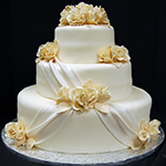 Ivory Weding Cake with Swag and Flowers