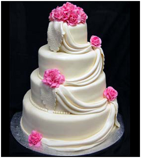 White Swag Wedding Cake